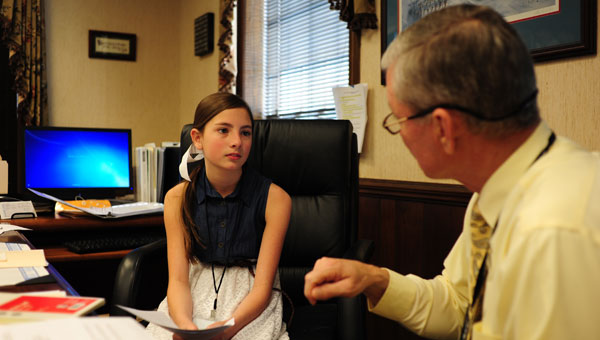 Valley Intermediate School fifth-grader Riley Coston, who was elected by her peers to serve as mayor for the day, speaks with Pelham Mayor Gary Waters in Waters' office at Pelham City Hall during Youth Government Day April 22. (Reporter Photo/Jon Goering)