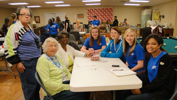 Calera Middle School NJHS students teach Calera Senior Center members to make a bead bracelet. Seated from left are Bernice Langston, Doris Threatt, Abby Gardner, Kaitlyn Cole, Savannah Gass, Nee Nee Swift. Standing is Pauline Jones. (contributed)