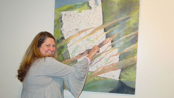 Artist Amy Feger talks about her paintings on maps currently on display in the Parnell Memorial Art Gallery. (contributed)