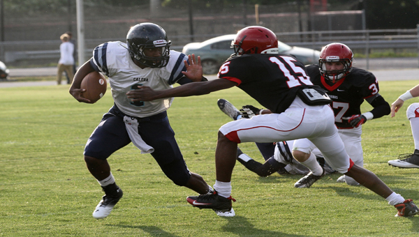 Calera running back Ronnie Clark (1) breaks a tackle in a spring football matchup against Thompson May 16.