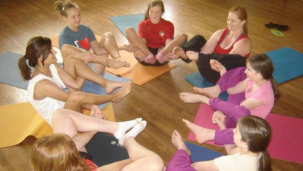 Enjoying last year's yoga camp are Instructor Cairisti Britton, Audrey Moore, Lauren Moore, Jo Northen, Kayla Smith, Alexandria Buttgereit and McKae Moon. (contributed)