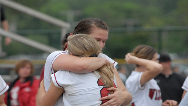 Pitcher Kaitlyn Paschall consoles Senior Jaselyn Harrison (2) after being eliminated in the Class 5A State Championships.