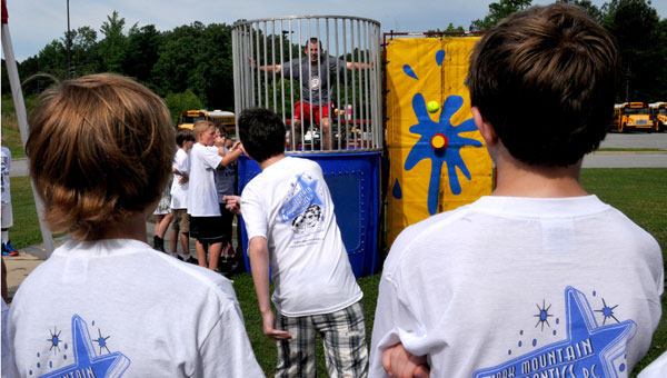 Coach Ryan Brewer was a popular figure in the dunk tank on HMS Husky Day. (contributed)