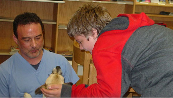 Dr. Thad Bamburg talks with Montevallo Middle student Caleb Cook about veterinary medicine. (contributed)