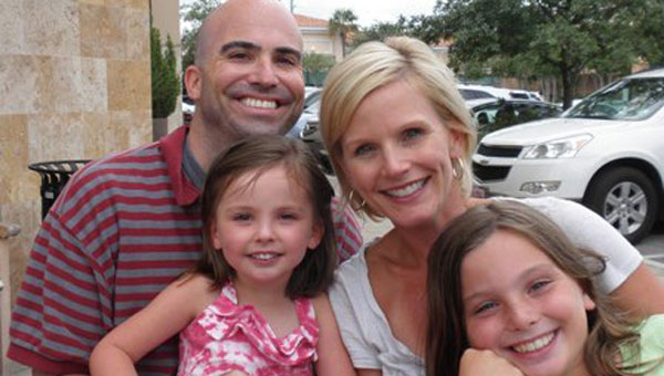 Laura Beth Monroe Gill, who died March 26 three months after being diagnosed with stage four lung cancer, is pictured with her husband Gene and daughters, Campbell and Caroline. (contributed)