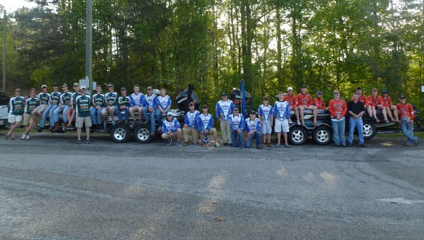 High School Anglers standing in front of two bass boats prepare to fish in the ASABFA state championship May 10-11, 2013 at Lay Lake. Pictured: Pelham High School team in green shirts, Coach Marc Howard, Tyler Howard, Jordan Humphries, Drew Wilson, Justin Woodruff, Austin Handley, Dalton Dewberry, Clint Nicholson, Tucker Brown, Travis Kem, Colin Hutto and Bailey Eason. Chelsea High School in blue/white shirts,  Coach Greg Loveday, Zane Loveday, Jason Champion, Tray Davis, J J Davis, Alex Boroughs, Hunter Preisendorfer, Tyler Boyle, Randy Joiner, Kaleb Appling, Quinton Dorough, Jake Johnson and Tayler Hulvey. Thompson High School in orange shirts,  Coach Mark Herring, Austin Herring, Colby Yessick, Nick Holt, Hunter Tate, Blake Green, Kyler Carter, Skylar Harris, Paxton Ray, Kaleb Brown and Dusty Heyer. (contributed)