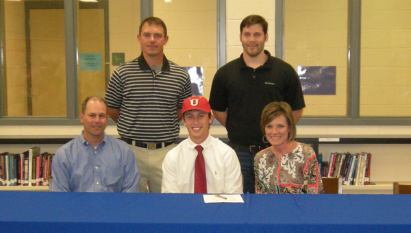 Chelsea High School senior Davis Shoemaker signed a baseball scholarship to play at Union University in Jackson, Tenn. Pictured are front row from left, Mike, Davis and Rachel Shoemaker. Back row, Chelsea head coach Michael Stallings and Josh Jones of Elite Baseball in Hoover. (Reporter photo/Mickel Ponthieux)