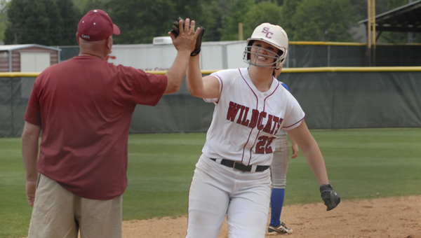 Shelby County's Kaitlyn Paschall celebrates with head coach Ashley Phillips after hitting her second home run against Chilton County at the Class 5A, Area 8 tournament May 1. (Reporter photo/Mickel Ponthieux)