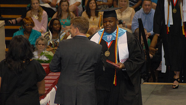 Thompson High School senior Class President Joshua Peeples receives his diploma from THS Principal Dr. Daniel Steele during the school's graduation ceremony on May 21 at UAB's Bartow Arena. (Reporter Photo/Neal Wagner)