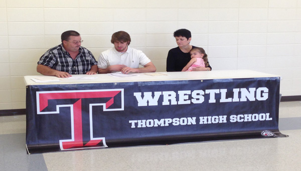 THS wrestler Nick Hall signs with Appalachian State on April 18. (Contributed)
