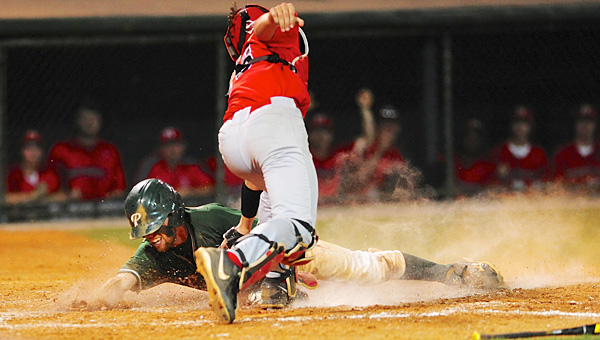 Pelham's Fletcher Johnson slides safely into home past a tag from the Hewitt-Trussville catcher in the bottom of the 7th to given Pelham a 3-2 victory in the first game of the AHSAA Class 6A State Championship game in Montgomery. (Reporter Photo/Jon Goering)
