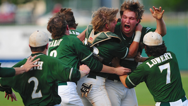 Pelham players mob pitcher Jack Pierce after Pierce finished off Hewitt-Trussville in game two to clinch the AHSAA Class 6A State Championship for the Panthers on May 18 at Riverwalk Stadium in Montgomery. (Reporter Photo/Jon Goering)