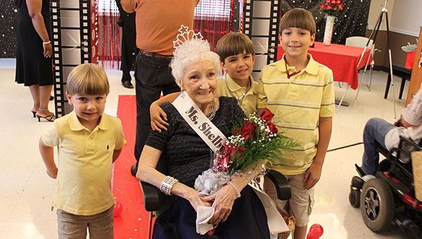Bessie Smitherman, posing with her three great-grandsons, was named Miss Shelby Ridge in 2011. The nursing home will hold its 2013 pageant on May 16. (File)