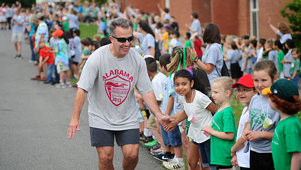 Officers with the Alabama Law Enforcement Torch Run greet kids at Pelham's Valley Elementary School on May 17. (Reporter Photo/Jon Goering)