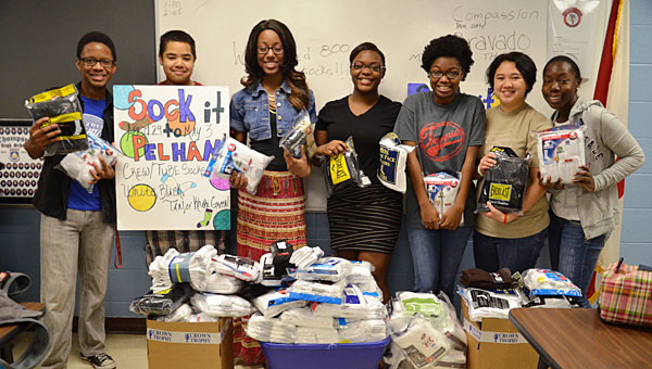 Members of the Thompson High School Junior ROTC team display the 800 pairs of socks they collected during the Socks for Soldiers campaign. (Contributed)
