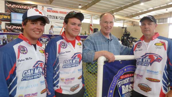 Gov. Robert Bentley returned to his hometown Columbiana May 11 for the ASABFA State Fishng Championship. He is pictured  with Oak Mountain High School team members Dylan McKee, William Ireland and Glenn Ireland. (Photo by Phoebe Donald Robinson/For the Reporter.)
