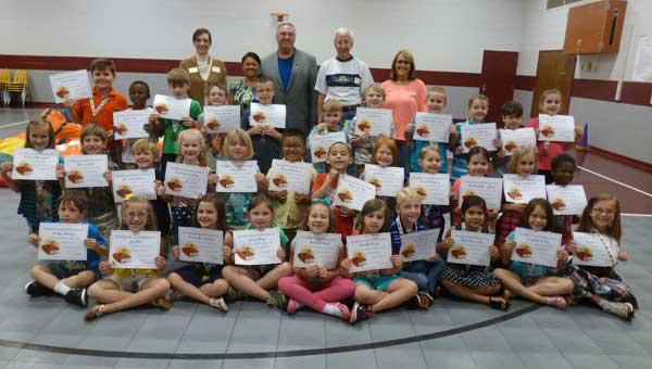 Elvin Hill Elementery School first grade students who read 150 books in the academic year at a May 10 celebration. Pictured: student winners with Columbiana Library Director Dutcha Lawson, Ann and Mayor Stancil Handley, volunteer Larry Otto and teacher Vicki Coe. (Photo by Phoebe Robinson.)