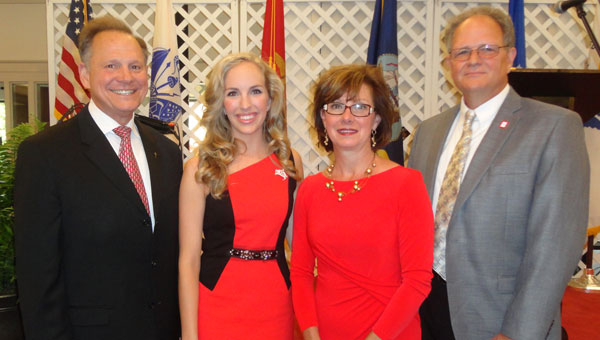 Chief Justice Roy Moore, left, joined Rachel, Charon and Thomas Rivers at the Support our Soldiers dinner. (contributed)