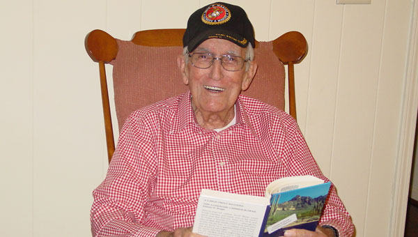 Ninety-year-old Malcolm McFarland reads another Western story. (contributed)