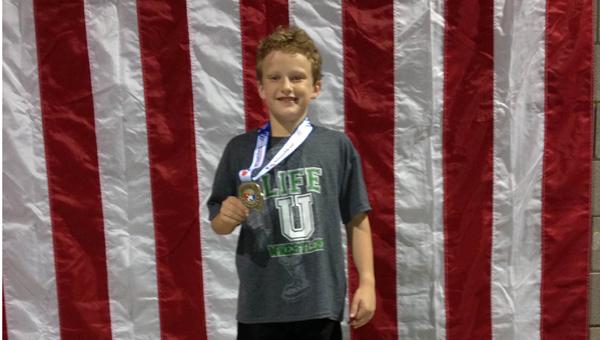 10-year-old Oak Mountain Intermediate's Sam Harris captured the USWA 75-pound Southeast Regional Intermediate Freestyle Wrestling Champion May 26.