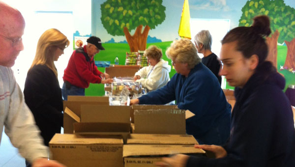 Calera First United Methodist members pack food boxes for needy families. (contributed)
