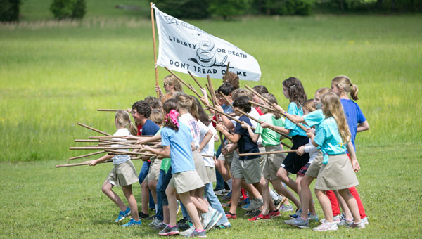 Children visiting the American Village join George Washington's Revolutionary Army to fight for freedom.  (Contributed)