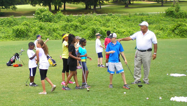 Members of the Montevallo Boys and GIrls Club work with golf professionals at the Montevallo Golf Course June 19. The sessions are part of a partnership between the Boys and Girls Club and the Montevallo Golf Club.