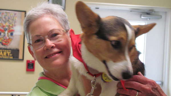 Beth Oedamer and Ollie the dog smile for the camera. (Contributed)