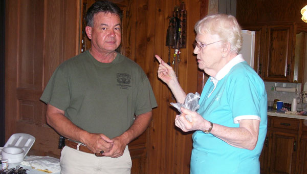 Delan Davis, left, and Sarah Davis Moler, both of Birmingham, share family stories and dinner at the Davis family reunion held recently at the Davis family home place near Pleasant Valley Baptist Church in Chelsea. (contributed)