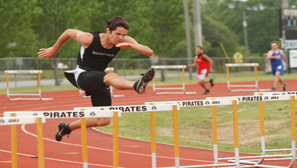 Westminster-Oak Mountain's Andrew Carrell clears a hurdle at the AHSAA Class 1A State Track meet. (Contributed/Ron Landers)