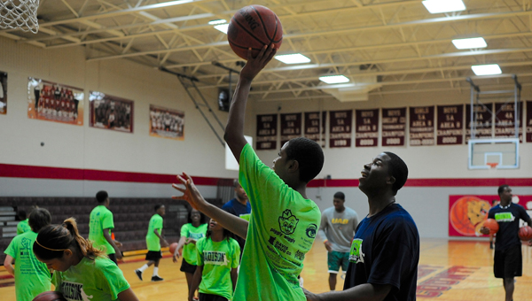 Campers and counselors, including Bobby Madison, work together at the Bobby Madison Basketball Camp in Columbiana on June 28. (Reporter Photo/Jon Goering)