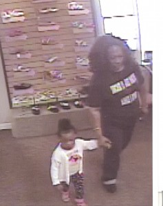 The woman pictured in this surveillance footage is facing credit card theft charges in Shelby County after she is released from the Jefferson County Jail. (Contributed)