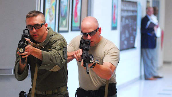 Deputies with the Shelby County Sheriff's Office search the halls for a simulated school shooter during an active shooter training exercise at Valley Intermediate School on June 11. (Reporter Photo/Jon Goering)