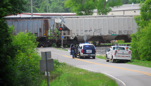 An Alabama State Highway Patrol officer works the scene of a train collision with a tractor-trailer on Shelby County 51 on June 19. (Reporter Photo/Jon Goering)