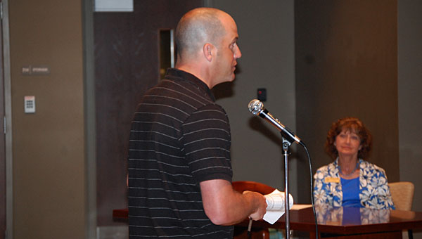 Jason Rhoads, a resident of the Bent Creek subdivision, speaks against possibly being rezoned from Chelsea schools to Pelham schools during a June 17 public hearing at the Pelham Municipal Courtroom. (Reporter Photo/Neal Wagner)