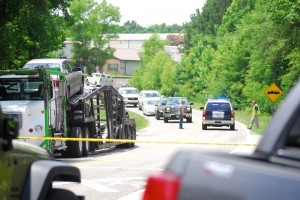 The driver of the tractor-trailer that was hit by the train on Shelby County 51 gets ready to move out of the way as the road reopens on June 19. (Reporter Photo/Jon Goering)