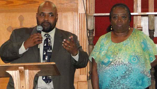 Pastor Kenneth Dukes and Joyce Lewis speak at a rally in support of section 5 of the Voting Rights Act on June 22 in Calera. (Photo by Mollie Brown.)