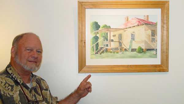 Artist, the Rev. John Wesley, talks about his paintings. (contributed)