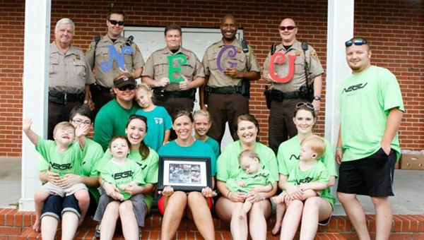 Pictured in front of Shelby County Sheriff's personnel are the honorees and fighters recognized at the Shelby County NEGU June 29. (Contributed)