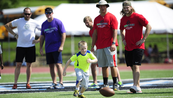 Camp coaches watch as players track down fumbles during the Joe Webb Football Camp on July 20 at Spain Park High School. (Reporter Photo/Jon Goering)