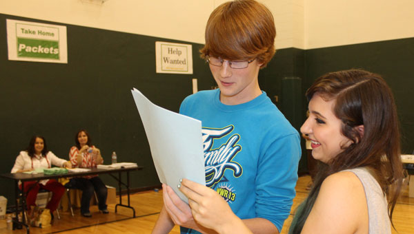At registration, PHS juniors Tyler Leak and Sarah Sansom compare schedules for the coming school year. (Contributed)