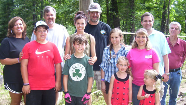 Gardening families Jennifer, Jeff and Joel Posey; Cammie, sandy, Sage and Grey Sanders; Brooke, Matt, Lilly and Claire Jackson and Bill Wheeler are enjoying growing vegetables in the Chelsea Community Garden. (contributed)