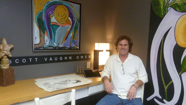 Scott Vaughn Owen sits among his art in his new studio OwenArts on Alabama 70 in Columbiana at his Sign Graphics location. (contributed)
