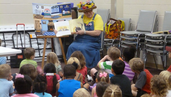 Miss Jeannie reads a book to children at Columbiana Public Library on Tuesdays at 9:30 a.m. (contributed)