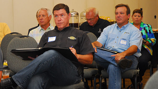 Pelham business owners Roberto Rodriguez, center, and Troy Crocker, right, listen to Pelham leaders during a July 23 city business council meeting at the Pelham Civic Complex and Ice Arena. (Reporter Photo/Neal Wagner)