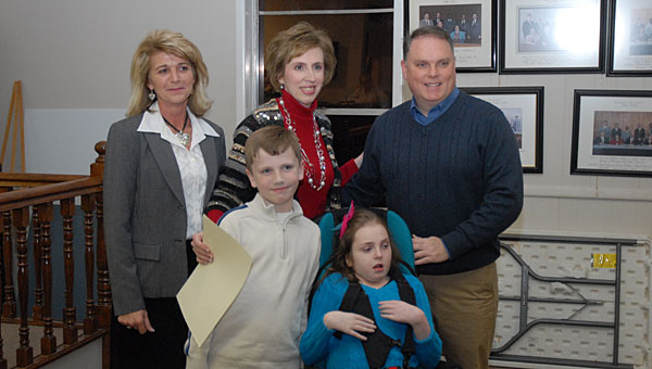 Alabaster's Long family with Alabaster Mayor Marty Handlon, right. The Longs are preparing to celebrate the national launch of their special-needs shopping cart. (File)