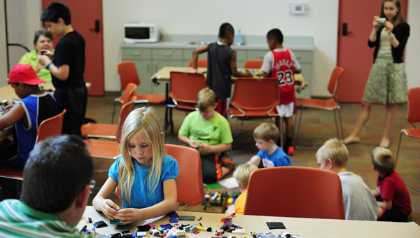 Six-year-old Capley Aaron builds with her dad, Jody, during Lego League at the Alabaster Public Library on July 9. (Reporter Photo/Jon Goering)