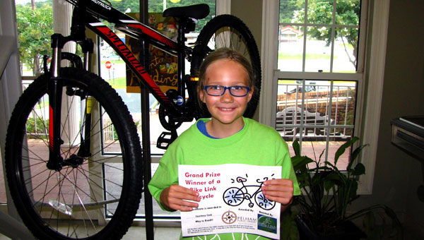 Courtney Cook won a Specialized bicycle after winning the Pelham Public Library's annual summer reading program. (Contributed)