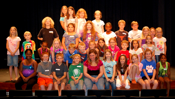 35 kids are participating in the Parnell Memorial Library's annual theater workshop this year. After rehearsal, they pose for a group photo.