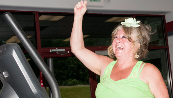 "Karen Rowland was first place winner in SNAP's Weight Loss Challenge in 2012, losing 21.6 percent of her total body weight. Here on the elliptical trainer, she vowed, ""As God is my witness, I will never be fat again!"" (contributed)"